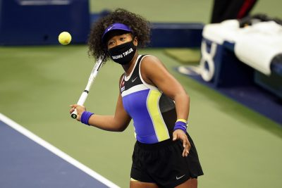 A person hitting a ball with a racket