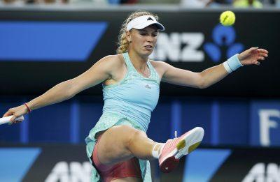Caroline Wozniacki hitting a ball with a racket