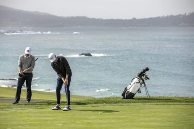 Two persons playing golf