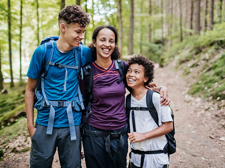 Mother and her two sons in forest