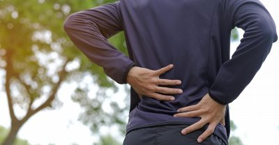 A person suffering from backpain