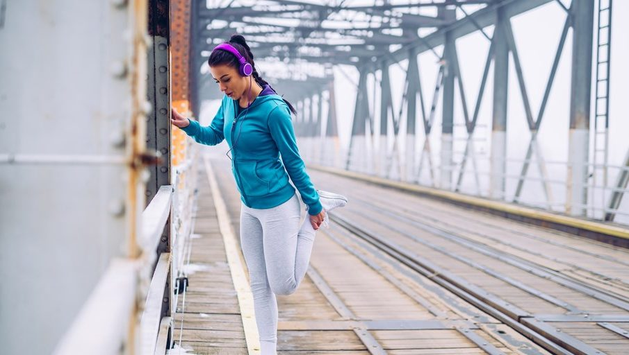A girl doing workout with listing music
